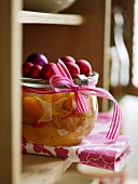 Exotic mustard fruits in a jar decorated for Christmas