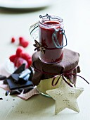 White chocolate caramel sauce and raspberry and chocolate sauce