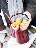 Cheese biscuits and savoury biscuits in a red pot