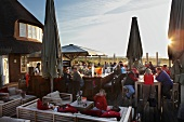 People sitting at bar and restaurant in dusk, Sylt Island, Schleswig-Holstein, Germany