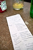 Close-up of shopping list on table in New York, USA