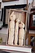 Three figures carved in wooden box, Bremen, Germany