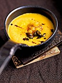 Cream of pumpkin soup with cinnamon apples and pumpkin seeds