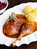 Christmas goose with mugwort, red cabbage and dumplings