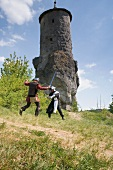 Two knights in front of small tower in Franconian Switzerland, Bavaria, Germany
