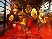 Kids watching wooden masks, Musee du Quai Branly, Paris, France