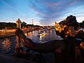 Pont Alexandre III over Seine river in night lights in Paris, France