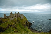 View of Dunluce Castle and Atlantic Ocean in Ireland, UK