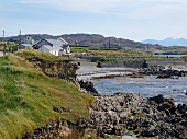 View rocky coast and houses in Inishbofin, Ireland