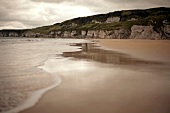 View of Antrim coast beach and sea in Ireland, UK