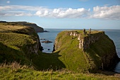 View of Antrim Coast cliffs and Dunseverick Castle, Ireland, UK