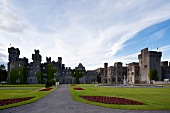 View of Ashford Castle with pavement and garden, Ireland, UK