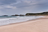 View of Antrim coast beach, sea and cliff in lreland, UK