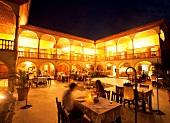 Guests sitting at table in Elaki Restaurant, Mehmet Ali Aga Mansion, Datca, Aegean, Turkey