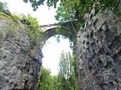 View of cliff bridge in Buttes Chaumont Park, Paris, France, low angle view
