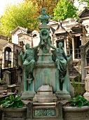 Grave of Crespin family with statues in Pere Lachaise Cemetery, Paris