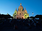 View of the Sacre Coeur at dusk in Paris, France