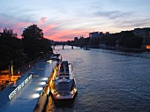 Ferry moored beside Pont Neuf in Seine river, Paris, France