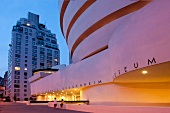 Exterior of Solomon R. Guggenheim Museum at night in New York, USA