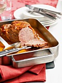 Roast veal with coriander sauce in a roasting tin
