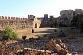 People in courtyard of ruined Mamure Castle in Anamur, Antalya, Turkey