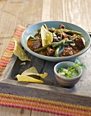 Beef stew with green beans and tacos
