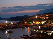 View of boats moored in harbour at sunset, Kas, Lycia, Antalya, Turkey