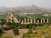 View of ruined wall and mountains in Aspendos, Antalya, Turkey