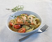 Salmon fillet on a fennel and tomato medley
