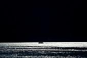 Ship in Lake Como at moonlight, Italy