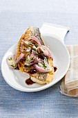 Fish fillets with balsamic vinegar and red onions (Italy)