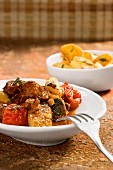 Lamb ragout with mint and fried potatoes (Italy)