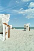 View of Sierksdorf beach with sun shade chair at Baltic Sea Coast