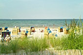 Tourist in summer with chairs at Scharbeutz beach, Baltic sea, Germany
