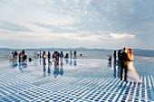 People at waterfront twilight in Zadar, Croatia