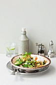 Bulgur with green vegetables, mint and poached eggs