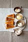 Orange cake with almonds and four different types of cream