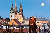 Couple kissing in front of Zagreb Funicular, Croatia