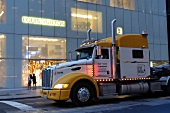 Truck in front of Louis Vuitton store, New York