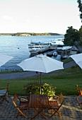 View of restaurant Oaxen Krog terrace overlooking the sea, Stockholm