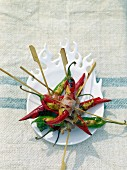 Stuffed hot chilli peppers on skewers
