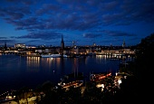 View of Stockholm cityscape at night with ships in Sweden