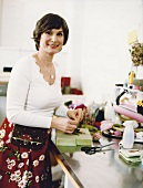 Portrait of Felt designer Gisela Damblon working on her workplace, smiling