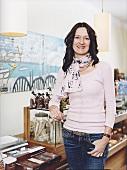 Chocolate maker Berit Windisch standing in her shop, smiling