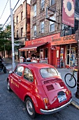 Red car parked on streets in Brooklyn, New York, USA