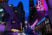 Neon signboards at Times Square at night, New York, USA