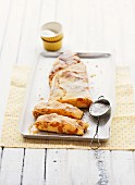 Apricot strudel with icing sugar