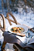 Turnip stew with meatball on a sledge in the snow