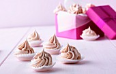 Pink meringue kisses as a gift
