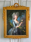 Close-up of picture frame with woman's painting in Versailles Palace